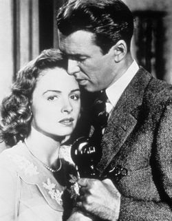 250px-Donna_Reed_with_James_Stewart_(1946)